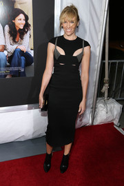 Toni Collette showed her edgier side in this sexy black cutout dress during the New York screening of 'Enough Said.'