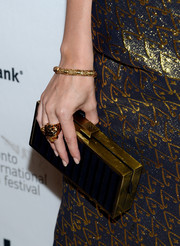 Tracey Fairaway sported a blue-gold theme at the 'Enough Said' premiere with this box clutch and evening dress combo.