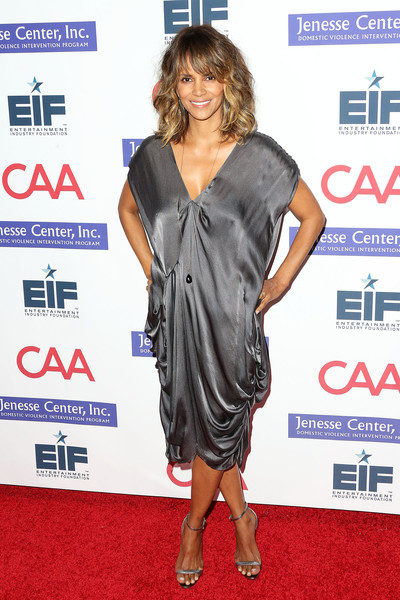 Halle Berry complemented her dress with a pair of silver ankle-strap sandals.