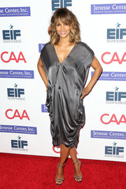 Halle Berry donned a draped gray silk dress for the Imagine benefit.