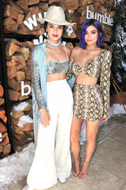 Kylie Jenner walked on the wild side in a snakeskin-print crop-top by TLZ L'Femme during Winter Bumbleland.
