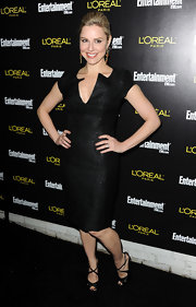Cara shimmered in a little black dress with a unique deep plunge neckline.