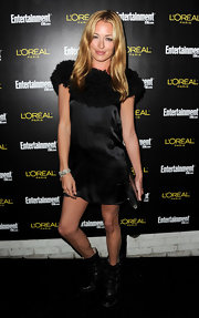 Cat Deely toughened up her silky LBD with clunky buckled black leather boots.