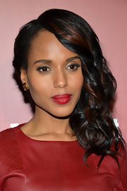 Kerry's deep side party added instant glamour to the star's evening look.
