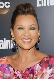Vanessa Williams swept her hair up into a sleek 'do with voluminous bangs.