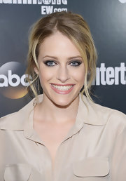 Carly Chaikin emphasized her baby blues by adding warm gray shadows to her creases and then sweeping on lots of creamy black liner and volumizing mascara.