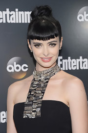 Krysten Ritter arrived at the Upfront VIP party wearing her shiny hair in a top knot with short blunt bangs.