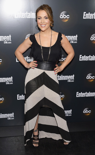 Alyssa Milano's strappy heeled sandals featured bands of sheer black ribbon.