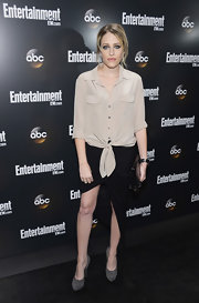 Carly Chaikin completed her understated look with a pair of dark gray suede pumps.