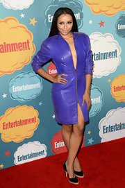 Kat Graham rocked a grape-hued zip-up leather dress at the EW Comic-Con celebration.