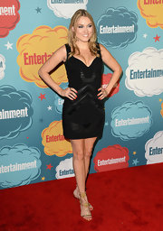 Clare Grant sported a classic black dress with stylized leather patch designs at the EW Annual Comic-Con celebration.