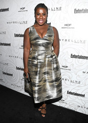 Uzo Aduba polished off her look with black cross-strap sandals by Jimmy Choo.