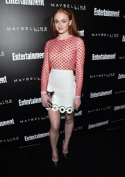 Sophie Turner kept up the playful vibe with a white cutout-hem mini skirt.