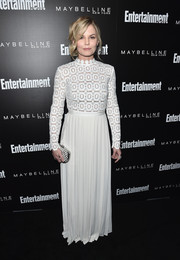 Jennifer Morrison kept it conservative in a long-sleeve, high-neck white gown by Self-Portrait at the Entertainment Weekly celebration honoring the SAG nominees.