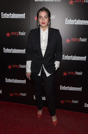 Alanna Masterson gave her boyish look a feminine flair with a pair of red pumps.