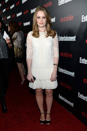 Cara Theobold went the vintage route in a white shift dress with lace sleeves and a tiered skirt when she attended the Entertainment Weekly SAG nominees celebration.