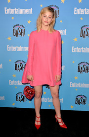 Lili Reinhart completed her colorful look with a pair of red Valentino Rockstud pumps.