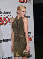 Katie Cassidy looked radiant at the Entertainment Weekly Comic-Con party sporting this gold clutch and dress combo.