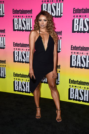 Kat Graham took a daring plunge in an asymmetrical-hem halter dress by Anthony Vaccarello for her Entertainment Weekly Comic-Con party look.