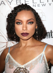 Logan Browning teamed a berry lip with heavily lined eyes for a bold beauty look.