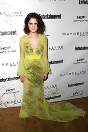 Laura Marano made a head-turning entrance in an embellished yellow fishtail gown by Thai Nguyen Atelier during Entertainment Weekly's SAG Awards nominees celebration.