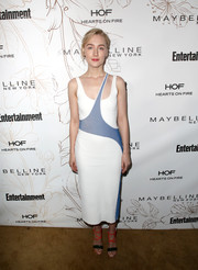 Saoirse Ronan styled her dress with strappy blue and red sandals by Christian Louboutin.