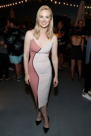 Deborah Ann Woll cut a shapely silhouette in a form-fitting midi dress in two shades of pink during the Entertainment Weekly and Marvel After Dark event.