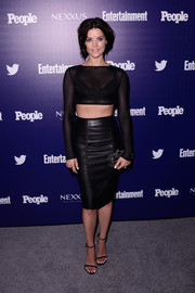 A studded black clutch by Alexander McQueen rounded out Jaimie Alexander's sexy-tough ensemble.