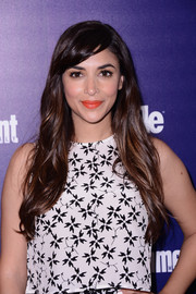 Hannah Simone's orange lipstick popped brightly against her monochrome outfit.