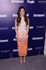 Miranda Cosgrove's Sophia Kah peplum dress at the Entertainment Weekly celebration of the New York Upfronts was given a modern and playful spin with an orange scribble-print skirt.