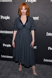Christina Hendricks attended the Entertainment Weekly and People New York Upfronts wearing a blue plaid dress with a plunging neckline.