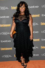Amber Riley went for subtle sexiness in a cleavage-baring black lace-overlay dress at the Entertainment Weekly pre-Emmy party.