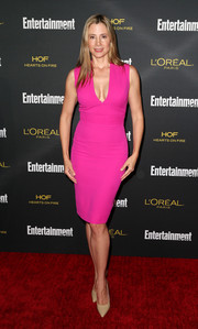 Mira Sorvino put her curves on display in a deep-V hot-pink Victoria Beckham sheath dress at the Entertainment Weekly pre-Emmy party.