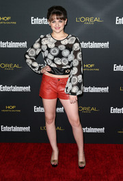 Joey King teamed her blouse with red leather shorts for a touch of fierceness.