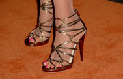 Raquel Welch chose a pair of ultra-glam gold strappy sandals for the Entertainment Weekly pre-Emmy party.