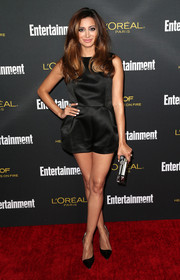 Noureen DeWulf complemented her romper with a pair of elegant black d'Orsay pumps.