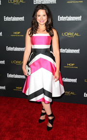 Katie Lowes completed her geometric-themed ensemble with a pair of black cutout boots.