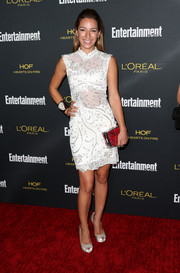 Vanessa Lengies added some color via a red floral box clutch.