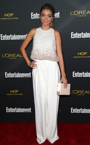 Sarah Hyland kept the white theme going with an Oroton box clutch.
