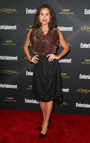 Minnie Driver chose a drapey black skirt to team with her blouse.