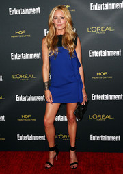 Cat Deeley completed her edgy-sexy ensemble with a pair of black ankle-cuff sandals.
