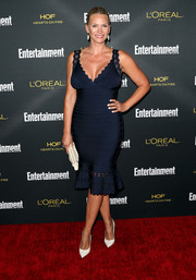 Natasha Henstridge wowed in a cleavage-revealing, hip-hugging navy bandage dress at the Entertainment Weekly pre-Emmy party.