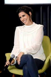 Jamie-Lynn Sigler kept it modest in a long-sleeve white ruffle blouse during Entertainment Weekly's PopFest.
