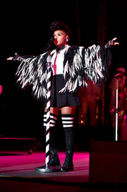 Janelle Monae performed during Entertainment Weekly's PopFest wearing a black mini skirt, a white button-down, and a bow tie.