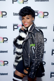 Janelle Monae posed backstage during Entertainment Weekly's PopFest wearing a mega-edgy studded leather jacket.