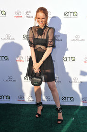 Black sandals with heavily embellished ankle straps completed Madelaine Petsch's ensemble.