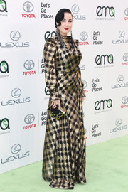 Dita Von Teese chose a metallic plaid gown by Vivienne Westwood for her EMA Awards look.