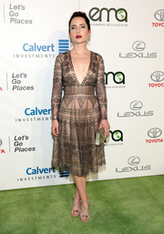 Zoe Lister Jones chose a pair of nude and silver Y-strap sandals to finish off her look.
