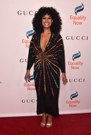 Tracee Ellis Ross coordinated her dress with a pair of embellished gold and lavender sandals.