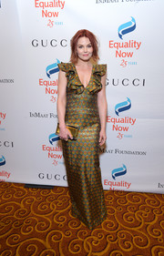 Jennifer Morrison complemented her dress with a gold box clutch.